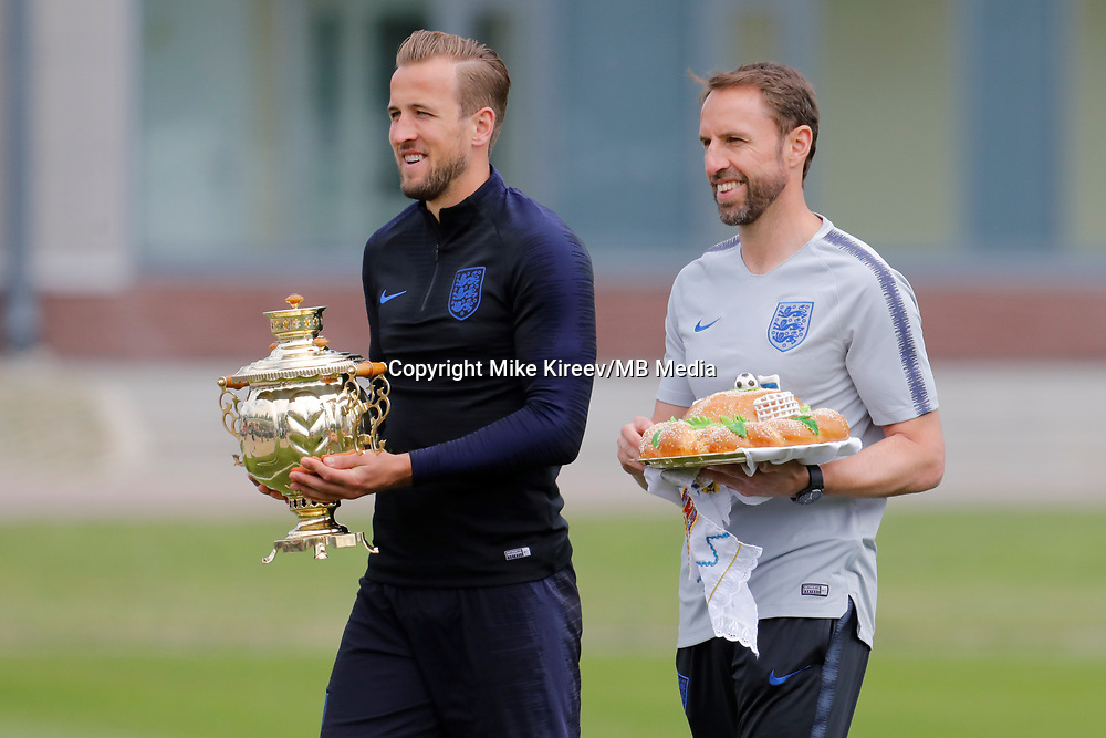 SAINT PETERSBURG, RUSSIA - JUNE 13: England national team head coach Gareth Southgate (R) and Harry Kane accept gifts before an England national team training session ahead of the FIFA World Cup 2018 in Russia at Stadium Spartak Zelenogorsk on June 13, 2018 in Saint Petersburg, Russia.