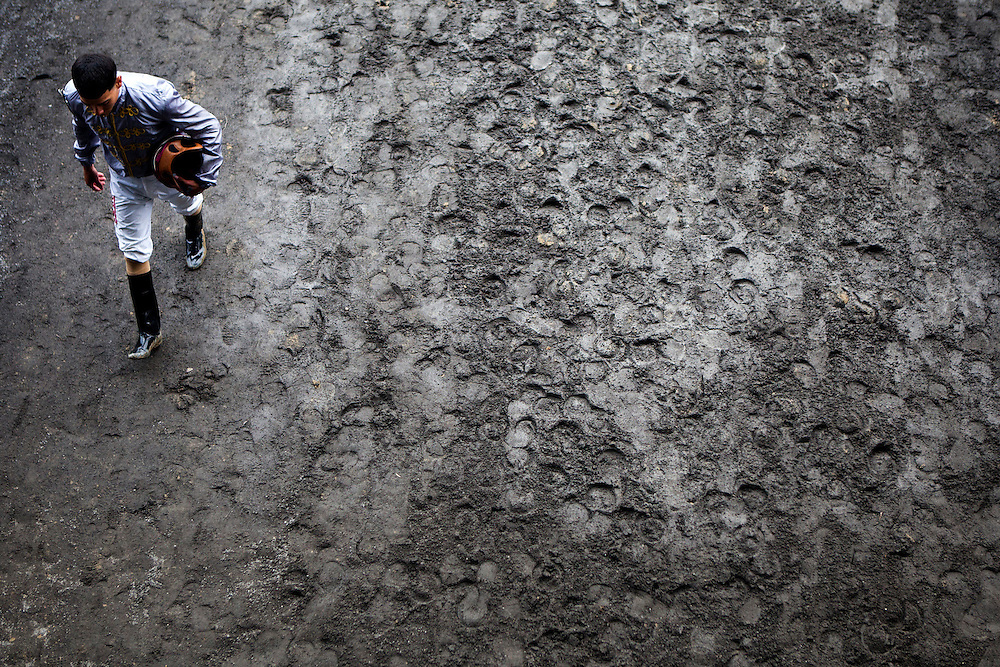 ELMONT, N.Y. - JUNE 6, 2015: A jockey leaves the track after a race prior to the 147th running of the Belmont Stakes at Belmont Park. CREDIT: Sam Hodgson for The New York Times