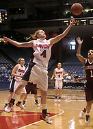 The Flyers Brittany Holterman (14) leaps, but is unable to reach a ball for the rebound, brought down by the Fordham Rams Lisa Carrol (1) as the Flyers Kiki Lund (4) looks on during a UD Women's basketball game at the University of Dayton Arena, January 21, 2007.