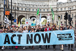 London, UK. 23rd April 2019. Climate change activists from Extinction Rebellion march from Marble Arch to Parliament Square to hold an assembly outside Parliament and to arrange for the delivery of letters from the activists requesting meetings with their Members of Parliament.