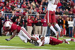 October 23, 2010; Stanford, CA, USA;  Stanford Cardinal running back Stepfan Taylor (33) dives for a touchdown past Washington State Cougars safety Jamal Atofau (25) during the second quarter at Stanford Stadium.