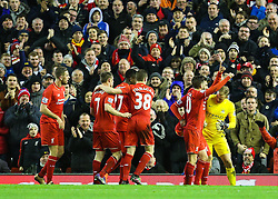 Roberto Firmino of Liverpool celebrates his sides third goal as Joe Hart of Manchester City wrestles to get the ball back - Mandatory byline: Matt McNulty/JMP - 02/03/2016 - FOOTBALL - Anfield - Liverpool, England - Liverpool v Manchester City - Barclays Premier League