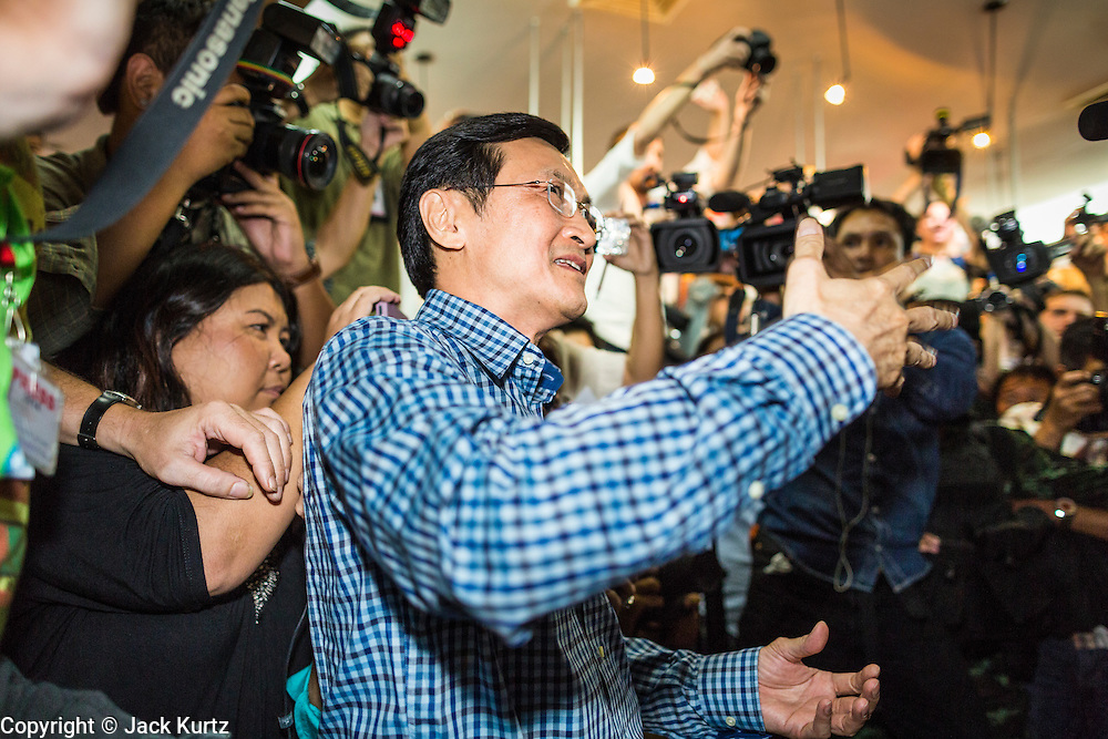 27 MAY 2014 - BANGKOK, THAILAND:  CHATURON CHAISANG talks to Thai soldiers shortly before they led him out of the Foreign Correspondents' Club of Thailand after arresting him during a press conference. Chaturon, a former Deputy Prime Minister and Education Minister and a senior member of the Pheu Thai Party (the party of the elected civilian government) was arrested by military authorities in Bangkok while he was talking to reporters at the Foreign Correspondents' Club of Thailand. A squad of soldiers came into the packed FCCT dining room, confronted Chaturon and led him to a waiting van.     PHOTO BY JACK KURTZ