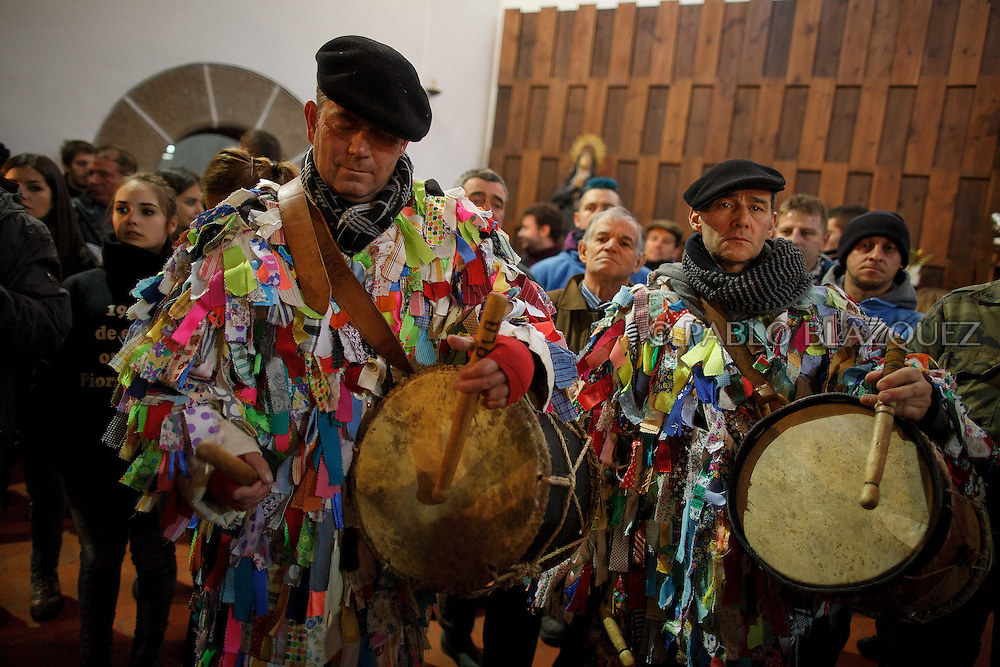 Carlos Calle (L) and Angel Cerro (R) play the drum during the Jarramplas Festival inside the church on January 20, 2015 in Piornal, Spain. The centuries old Jarramplas festival takes place annually every January 19-20 on Saint Sebastian Day. Even though the exact origins of the festival are not known, various theories exist including the mythological punishment of Caco by Hercules, a relation to ceremonies celebrated by the American Indians that were seen by the first conquerors, to a cattle thief ridiculed and expelled by his village neighbours. It is generally believed to symbolize the expulsion of everything bad. This year the people who represented Jarramplas were Angel Cerro Fernandez on 19 January and Carlos Calle Rodríguez 47 and Raúl Beites Sánchez 34 on 20 January.
