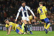 Leeds United defender Liam Cooper (6) tackles West Bromwich Albion forward Hal Robson-Kanu (4) during the EFL Sky Bet Championship match between West Bromwich Albion and Leeds United at The Hawthorns, West Bromwich, England on 10 November 2018.