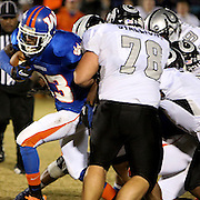 Whiteville's Aljere Adams is stopped by South Columbus' Perry Keene. (Jason A. Frizzelle)