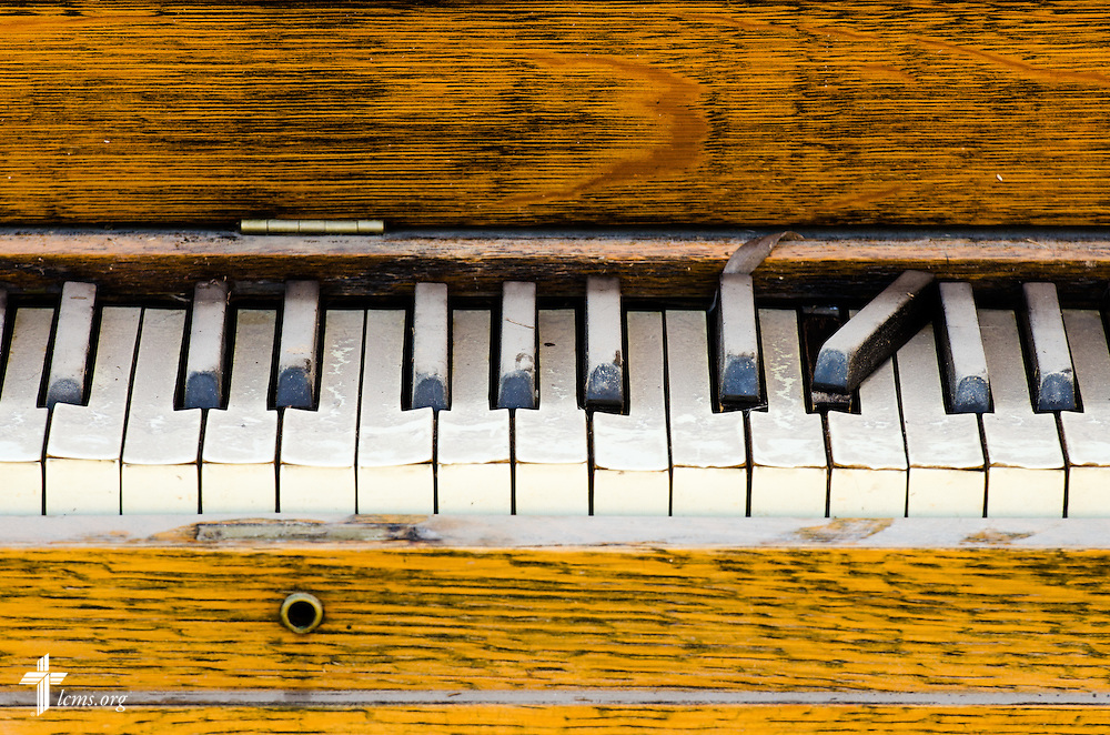 A damaged piano sits on the curb of a flood-damaged neighborhood on Saturday, May 3, 2014, in Pensacola, Fla. LCMS Communications/Erik M. Lunsford