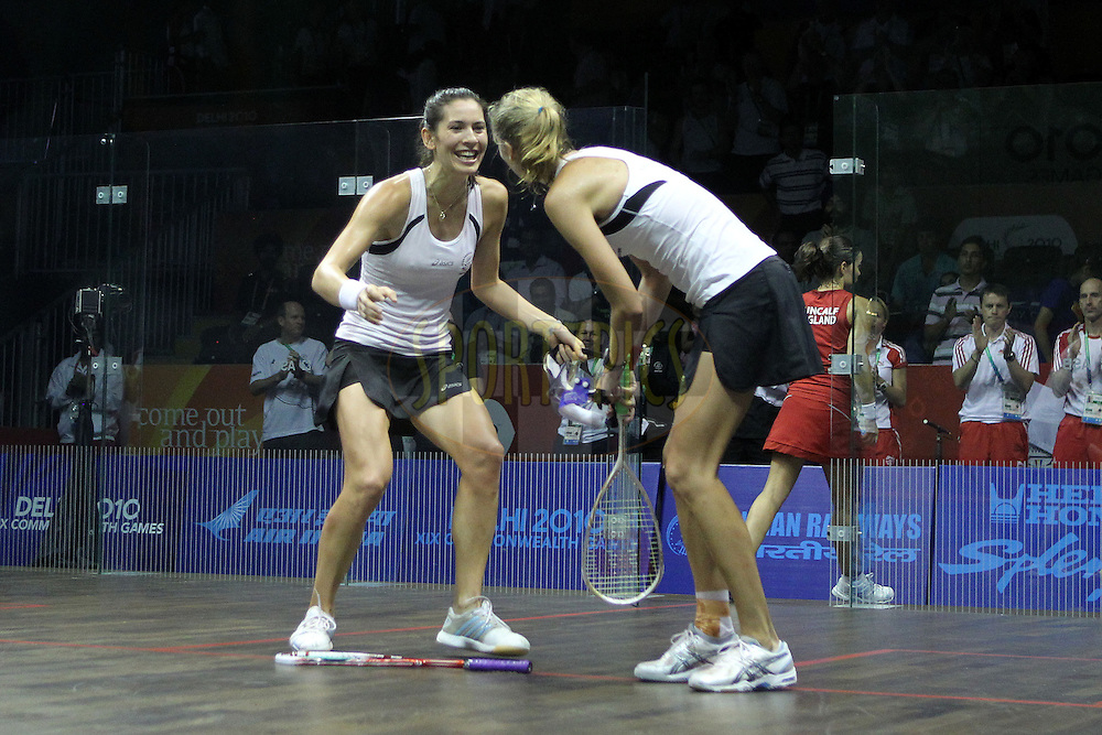 Joelle King and Jaclyn Hawkes of New Zealand celebrate winning the gold medal by beating  Jenny Duncalf and Laura Massaro of England during the final of the women's doubles squash competition held at the Siri Fort Complex in New Delhi as part of the XIX Commonwealth Games, India on the 13 October 2010..Photo by:  Ron Gaunt/photosport.co.nz