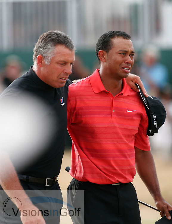 Tiger Woods with caddy steve williams walks of the 18th green after winning in an emotional state crying with tears streaming down his face during the final round on 23rd July 2006<br /> The Open Championship 2006, Royal Liverpool GC, Hoylake, England,UK.<br /> Picture Credit: Phil Inglis / visionsingolf.com