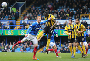 Shrewsbury Town defender Jermaine Grandison beats Portsmouth striker Ryan Taylor in the air during the Sky Bet League 2 match between Portsmouth and Shrewsbury Town at Fratton Park, Portsmouth, England on 28 March 2015.