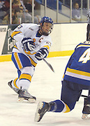 Lake Superior State University's Rick Schofield (left) shoots during the first period  of the Lakers Friday night 4-3 win over the University of Alaska Fairbanks at Taffy Abel Arena in Sault Ste. Marie.
