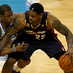 Mar 24, 2010; New Orleans, LA, USA; New Orleans Hornets guard Chris Paul (3) guards Cleveland Cavaliers forward LeBron James (23) during the second half at the New Orleans Arena. The Cavaliers defeated the Hornets 105-92. Mandatory Credit: Derick E. Hingle-US PRESSWIRE