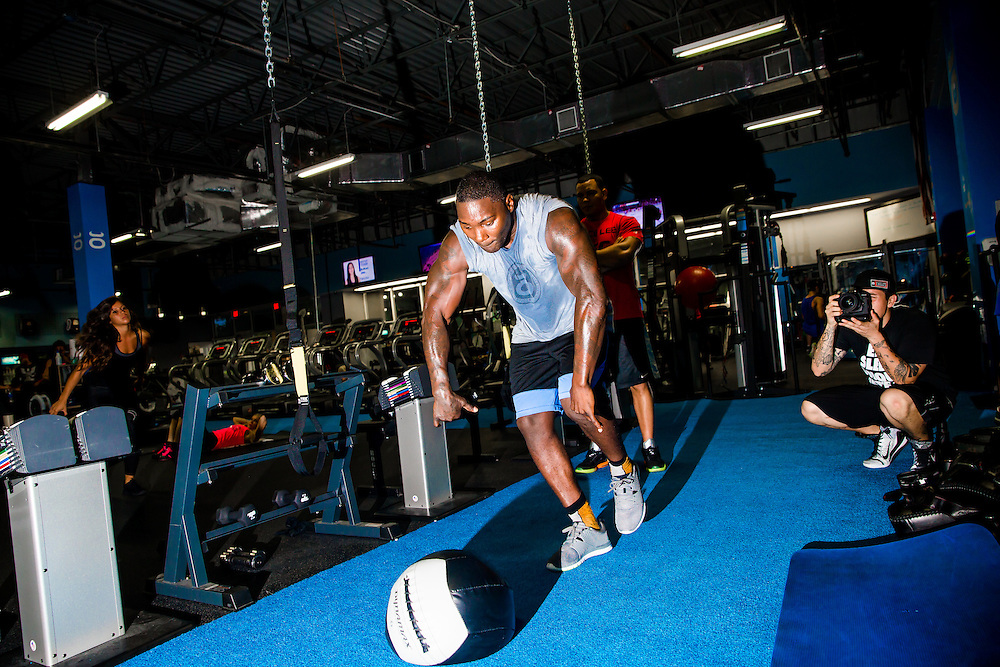 "BOCA RATON, Fla. (April 27, 2015) – MMA fighter Anthony ""Rumble"" Johnson does drills with trainers Dareick Barr (red shirt) and Jake Bonacci (black shirt) during training for his upcoming match against Jon Jones - who was replaced by Daniel Cromier after Jones' legal issues - at Jaco Hybrid Training Center in Boca Raton, Florida. (Photo by Chip Litherland for ESPN the Magazine)"