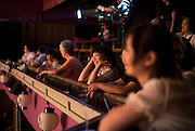 Visitors enjoy a Taisho-engeki performance at Korakukan theater, Japan's oldest extant wooden playhouse in Kosaka, Akita Prefecture Japan on 19 Dec. 2012.  Made entirely from wood, the theater was opened in 1910 and was registered as an Important Cultural Property in 2007. Photographer: Rob Gilhooly