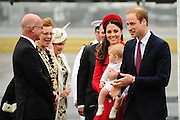Britain's Prince William and his wife Catherine are greeted by Wellington Mayor Celia Wade-Brown and her husband Alastair Nicholson (left). Behind them are Prime Minister John Key and his wife Bronagh Key. They arrived at the international airport in Wellington on April 7, 2014.  William, Kate and their son Prince George are on a three-week tour of New Zealand and Australia.    AFP PHOTO / MARK TANTRUM