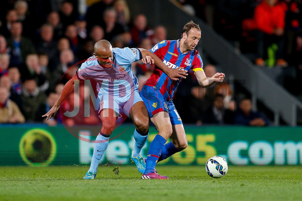 Glenn Murray of Crystal Palace is challenged by Vincent Kompany of Manchester City - Photo mandatory by-line: Rogan Thomson/JMP - 07966 386802 - 06/04/2015 - SPORT - FOOTBALL - London, England - Selhurst Park - Crystal Palace v Manchester City - Barclays Premier League.