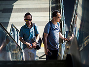 06 DECEMBER 2018 - SAMUT PRAKAN, THAILAND:  Men ride the escalator up to the platform of the Kheha station, the last station on the BTS Skytrain east extension. The 12.6 kilometer (7.8 miles) east extension of the Sukhumvit Line of the Bangkok BTS Skytrain goes into Samut Prakan, a town east of Bangkok.  The system is now 51 kilometers long (32 miles), including the 12.6 kilometer extension that opened December 06. About 900,000 people per day use the BTS.     PHOTO BY JACK KURTZ