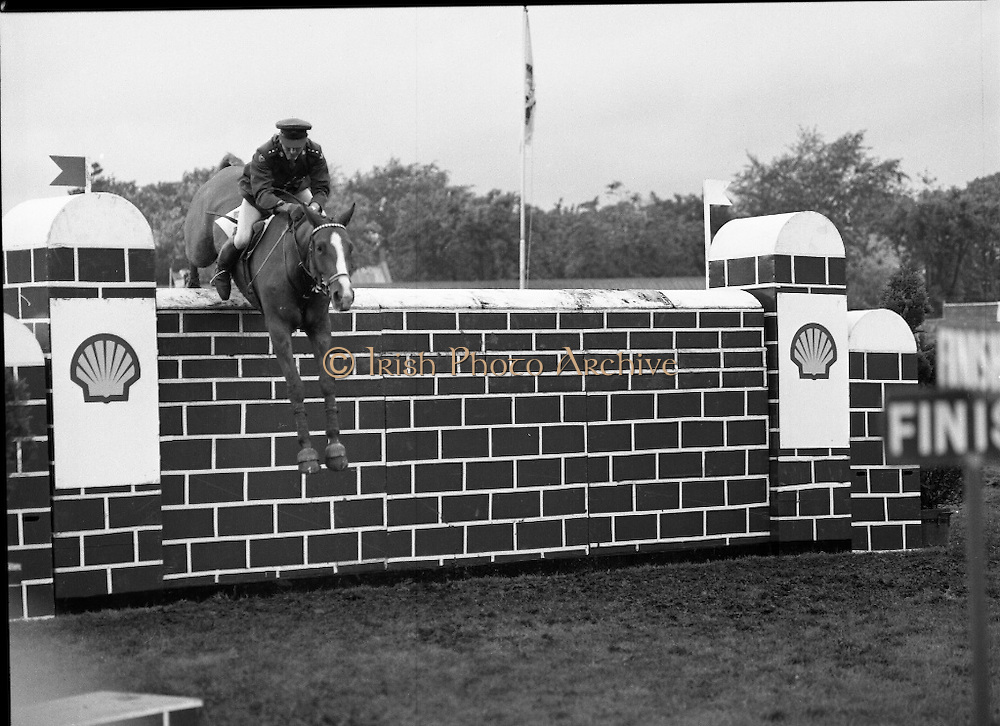 Shell Sponsored Events At The Dublin Horse Show.(R39).1986..07.08.1986..08.07.1986..7th August 1986..At the Horse Show Shell sponsored both the Speed and Power competition and The Puissance..The Speed and Power event was won by Hap Hanson riding 'Gambrinus'. The Puissance was shared by Capt John Ledingham (Irl) on 'Kilcoltrim' and Nick Skelton (GB) on 'Raffles Apollo' who both cleared the high wall at 7feet...Picture shows Capt John Ledingham on 'Kilcoltrim'clearing the wall at 7 feet on 'Raffles Apollo to tie the event with Nick Skelton (GB)