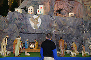 Steve Falter, who though he lives nearby, is getting a first look at the large historic nativity at St. Mary Catholic Church in Dayton, Tuesday, December 27, 2011.  The church spends about 120 person-hours creating the nativity, adding the baby Jesus on December 24th.