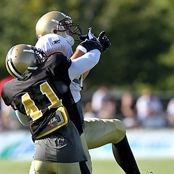 August 9, 2011; Metairie, LA, USA; New Orleans Saints safety Roman Harper (41) knocks away a pass from tight end Jimmy Graham (80) during training camp practice at the New Orleans Saints practice facility. Mandatory Credit: Derick E. Hingle
