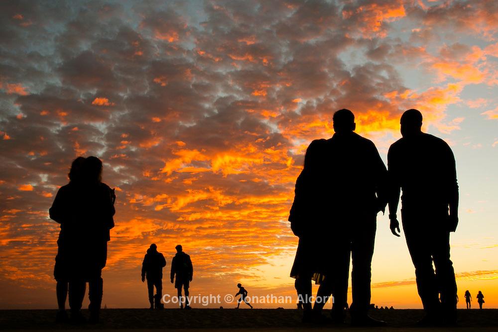 The sun sets as seen from Venice beach in  Los Angeles, California, U.S November 19, 2016.  Jonathan Alcorn