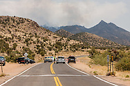 As the dean Peak wildfire spreads,Mohave County Sheriff's deputies work to enforce road closure and evacuation order on the Hualapai Mountain road