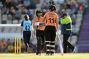 Danielle Wyatt and Suzie Bates of Southern Vipers meet as Danielle Wyatt hits the first six of the innings during the Women's Cricket Super League match between Southern Vipers and Yorkshire Diamonds at the Ageas Bowl, Southampton, United Kingdom on 21 August 2019.