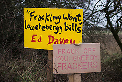 "© Licensed to London News Pictures . 24/01/2014 . Barton Moss Road , Manchester , UK . Signs reading "" Fracking won't lower energy bills "" attributed to Ed Davey , the Liberal Democrat Secretary of State for Energy and Climate Change and another reading "" Frack off you greedy frackers "" . Site of a protest camp on Barton Moss Road where anti-fracking demonstrators are based on an access road leading to an iGas fracking site as today (24th January 2014) Greater Manchester Police announce two further arrests from the ongoing protest after reporting that a security guard was threatened and assaulted on Barton Moss Road on Monday (20th January 2014) . Photo credit : Joel Goodman/LNP"