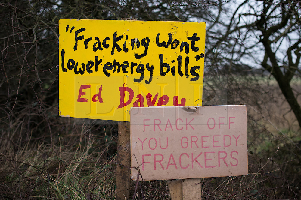 """© Licensed to London News Pictures . 24/01/2014 . Barton Moss Road , Manchester , UK . Signs reading """" Fracking won't lower energy bills """" attributed to Ed Davey , the Liberal Democrat Secretary of State for Energy and Climate Change and another reading """" Frack off you greedy frackers """" . Site of a protest camp on Barton Moss Road where anti-fracking demonstrators are based on an access road leading to an iGas fracking site as today (24th January 2014) Greater Manchester Police announce two further arrests from the ongoing protest after reporting that a security guard was threatened and assaulted on Barton Moss Road on Monday (20th January 2014) . Photo credit : Joel Goodman/LNP"""