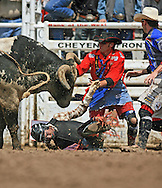 Bull Rider Jeffrey Orchard gets assistance from the Bull Fighters after getting tossed from #9 Ivan Ashworth JO Bull, 27 July 2007, Cheyenne Frontier Days