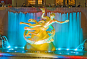 The Prometheus Sculptue (1934) by Paul Manship illuminated at night at Rockefeller Plaza fountain, New York City.