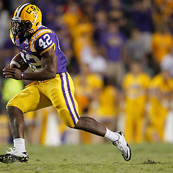 November 13, 2010; Baton Rouge, LA, USA; LSU Tigers running back Michael Ford (42) runs against the Louisiana Monroe Warhawks during the second  half at Tiger Stadium. LSU defeated Louisiana-Monroe 51-0.  Mandatory Credit: Derick E. Hingle