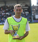 Dundee captain Kevin Thomson with the Angus Trophy Centre Cup  - Dundee v Manchester City  at Dens Park<br /> <br />  - &copy; David Young - www.davidyoungphoto.co.uk - email: davidyoungphoto@gmail.com
