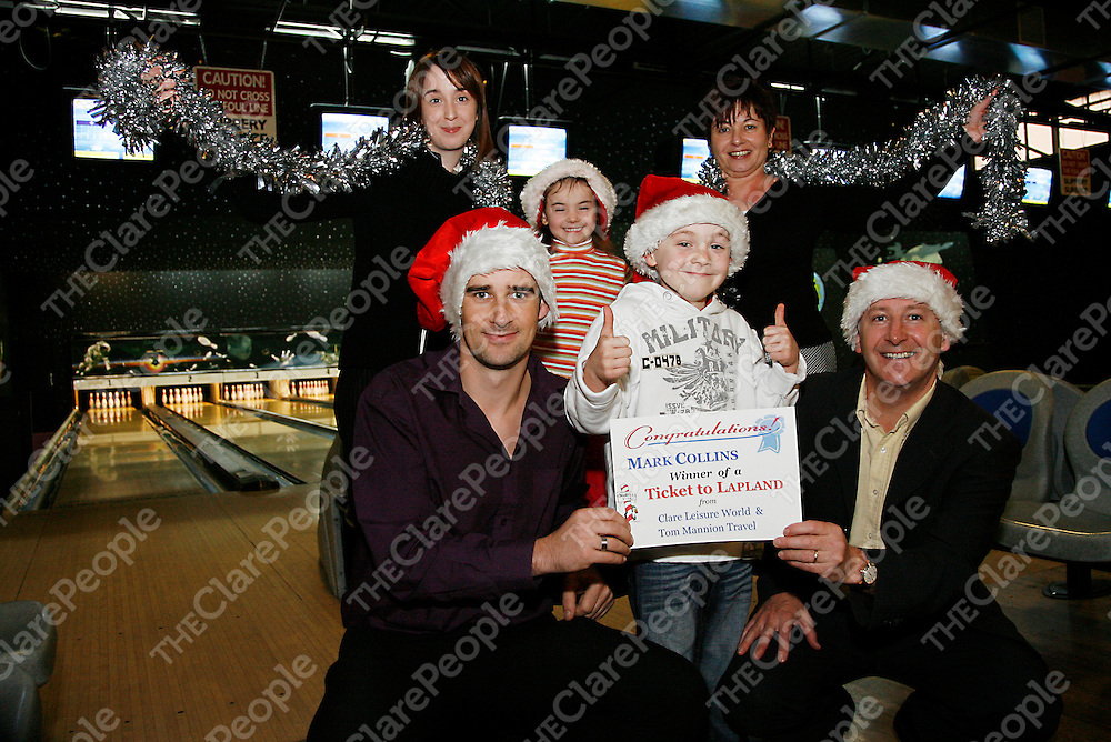 A delighted Mark Collins with Mum Noreen (back right) and sister Anna receives his tickets for his trip to Lapland from Joan Melvin - marketing executive Clare Leisure Centre, Eoin Farrell - manager of the Clare Leisure Centre and Gearoid Mannion of Tom Mannion Travel.<br /><br /><br /><br />Photograph by Yvonne Vaughan.