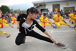 LIUZHOU, Sept. 7, 2016 (Xinhua) -- Wu Zhongyan (Front), a rural primary school teacher, teaches her students martial arts in Gaoma Village Primary School, where most students are ''left-behind children'', in Liuzhou, south China's Guangxi Zhuang Autonomous Region. The phrase is used in China to describe rural children whose parents work in other cities. Left-behind children usually live with relatives, often their grandparents, while their parents work away from home. . (Xinhua/Long Tao) (wyl) (Credit Image: © Long Tao/Xinhua via ZUMA Wire)