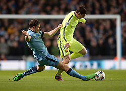 James Milner of Manchester City tries to tackle Lionel Messi of Barcelona - Photo mandatory by-line: Alex James/JMP - Mobile: 07966 386802 - 24/02/2015 - SPORT - Football - Manchester - Etihad Stadium - Manchester City v Barcelona - Champions League - Round of 16