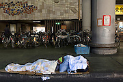 Homeless day laborers staying during the day at Airin Labor Welfare Center in Airin. The old name of the area untill 1966, was Kamagasaki and many people still call it like that. .Kamagasaki (????) is an old place name for a part of Nishinari-ku in Osaka, Japan. Airin-chiku (???????) became the region's official name in May, 1966.Sections of four different towns: Nishinari-ku Taishi (??????), Haginochaya (?????), Sanou (???), North Hanazono (????) and Tengachaya (?????) are collectively known as the Kamagasaki region..Kamagasaki as a place name existed until 1922. Kamagasaki is known as Japan's largest slum, and has the largest day laborer concentration in the entire country. 30,000 people are estimated to live in every 2,000 meter radius within this region. An accurate count of occupants has never been produced, even in the national census, due to the large population of day laborers who lack permanent addresses.