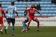 Coventry City defender, on loan from Southampton, Jack Stephens (15)  and Swindon Town forward Jonathan Obika (20)  during the Sky Bet League 1 match between Coventry City and Swindon Town at the Ricoh Arena, Coventry, England on 19 March 2016. Photo by Simon Davies.