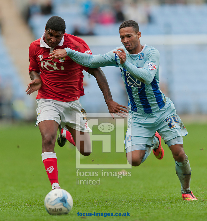 Jordan Clarke of Coventry City looks to block Mark Little of Bristol City during the Sky Bet League 1 match at the Ricoh Arena, Coventry<br /> Picture by Russell Hart/Focus Images Ltd 07791 688 420<br /> 18/10/2014