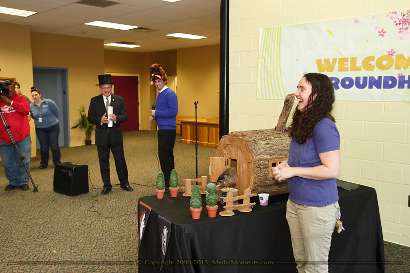 Rosie comes out of her weather hutch and nibbles first on a treat on the Denver stump, predicting both that there would be an early Spring (since she didn't see her shadow,) and that the Denver Broncos would win the Super Bowl in front of a crowd in the education center at the Boonshoft Musum of Discovery in Dayton, Sunday, February 2, 2014.  This is the first time that Rosie, the Discovery Zoo's resident groundhog and part time weather predictor, has predicted the outcome of a major football game.