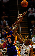 PHOTO BY DAVID RICHARD.Cleveland's Eric Snow gets his hand of the face of Kobe Bryant of Los Angeles on a shot attempt March 19.