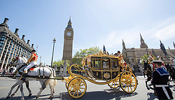 LONDON - UK- 27- MAY -2015:  HM Queen Elizabeth departs by carriage from the Palace of Westminster after the annual State Opening of Parliament Ceremony.<br /> Photograph by Ian Jones