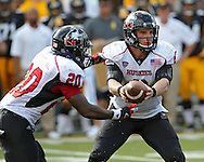 August 31 2013: Northern Illinois Huskies quarterback Jordan Lynch (6) hands the ball off to Northern Illinois Huskies running back Keith Harris Jr. (20) during the second quarter of the NCAA football game between the Northern Illinois Huskies and the Iowa Hawkeyes at Kinnick Stadium in Iowa City, Iowa on August 31, 2013. Northern Illinois defeated Iowa 30-27.