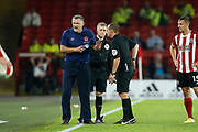 Referee Geoff Eltringham talks to Tony Mowbray of Blackburn Rovers during the EFL Cup match between Sheffield United and Blackburn Rovers at Bramall Lane, Sheffield, England on 27 August 2019.