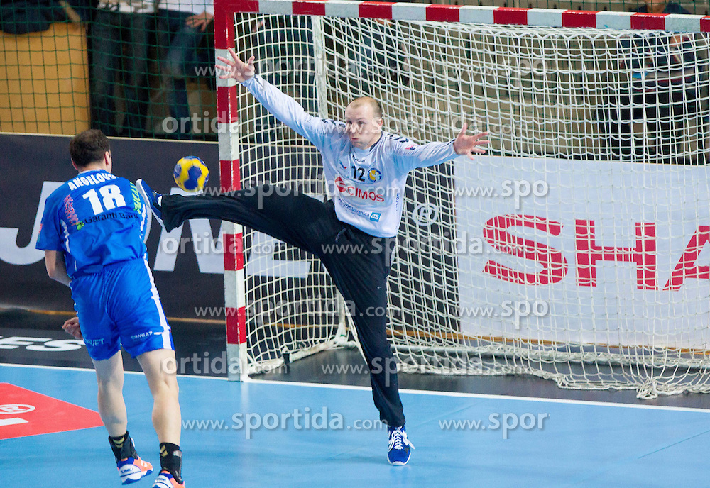 Branislav Angelovski of Constanta vs Gorazd Skof of Cimos Koper during handball match between RK Cimos Koper and HCM Constanta in 10th Round of season 2011/2012 of EHF Men's Champions League, on February 25, 2012 in Arena Bonifika, Koper, Slovenia. Cimos Koper defeated Constanta 28-24. (Photo By Vid Ponikvar / Sportida.com)