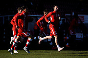 Crawley Town players start their warm up during the EFL Sky Bet League 2 match between Crawley Town and Macclesfield Town at The People's Pension Stadium, Crawley, England on 23 February 2019.