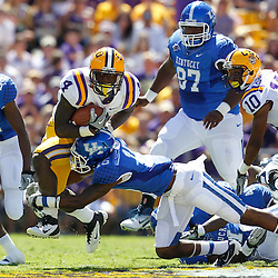 October 1, 2011; Baton Rouge, LA, USA;  LSU Tigers running back Alfred Blue (4) is tackled by Kentucky Wildcats safety Martavius Neloms (15) during the second quarter at Tiger Stadium.  Mandatory Credit: Derick E. Hingle-US PRESSWIRE / © Derick E. Hingle 2011