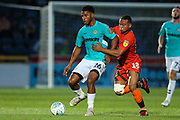 Forest Green Rovers Reuben Reid(26) holds off Wycombe Wanderers Curtis Thompson(18) during the 2nd round of the Carabao EFL Cup match between Wycombe Wanderers and Forest Green Rovers at Adams Park, High Wycombe, England on 28 August 2018.