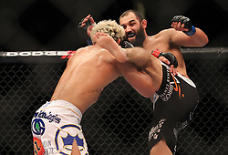 East Rutherford, NJ - May 05, 2012: Johny Hendricks (Black trunks) and Josh Koscheck (White trunks) during UFC on FOX 3 at the Izod Center in East Rutherford, New Jersey.