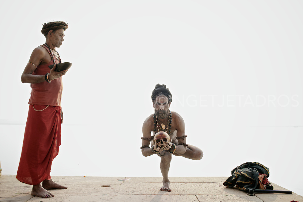 Baba G (L) and Rahm (R) during a morning ritual along the Ganges River. Varanasi, India.
